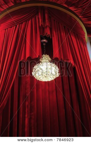 Chandelier With Red Curtains