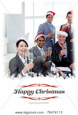 Manager and his team with novelty Christmas hat toasting at a party against border