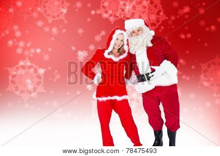 Santa and Mrs Claus smiling at camera against digitally generated delicate snowflake design