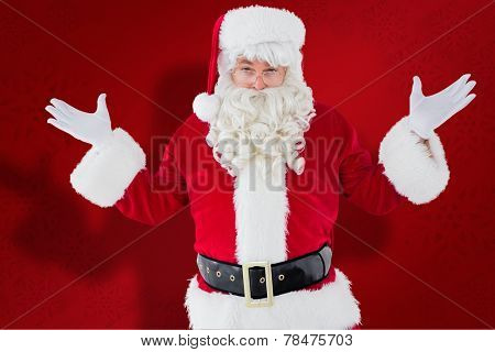 Portrait of perplexed santa against red snowflake background