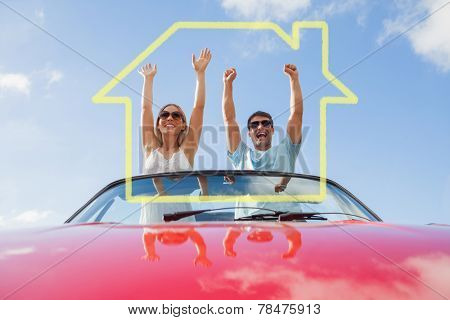 House outline against crazy couple standing in red cabriolet