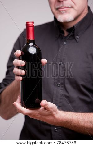 Bottle Of Red Wine And Hands Of A Man