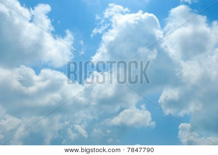 Bright Sunny Clouds Against Blue Sky