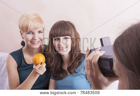 Happy Caucasian Girlfriends With Dental Bracket System Installed Are Being Photographed By Theirs Fr