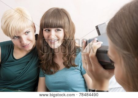 Caucasian Girlfriends With Dental Bracket System Installed Are Being Photographed By Theirs Friend
