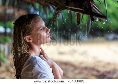 Blonde Woman At The Beach Under The Rain