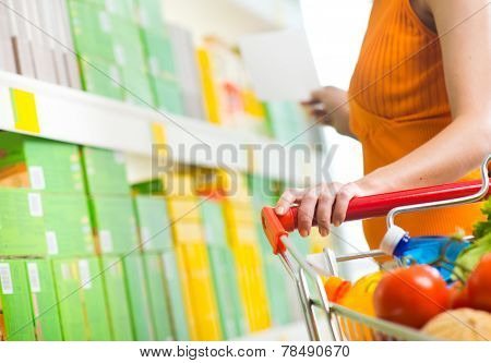 Woman Choosing Products On Shelf