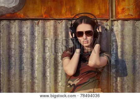 Young Woman with Big Headphone in Army Camouflage T-shirt