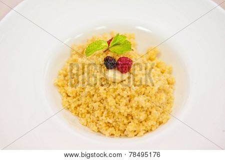 Millet porridge with berry closeup