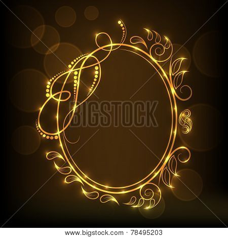 Beautiful golden floral design decorated frame in oval shape on shiny brown background.