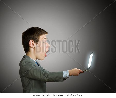 Young shocked man with big head looking in notepad