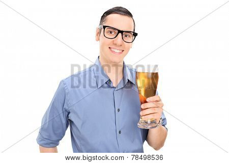 Cheerful young guy holding a pint of beer isolated on white background