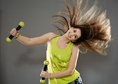 image of cardio exercise  - Fitness young woman doing cardio aerobic exercises with light dumbbells - JPG