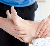 stock photo of foot massage  - Close - JPG