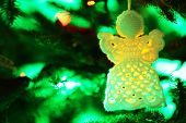 pic of christmas angel  - Knitted Christmas angel on Christmas lights background - JPG