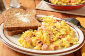 pic of scrambled eggs  - Scrambled eggs with diced ham and cheese and hot buttered sprouted whole wheat toast - JPG