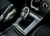 stock photo of gear-shifter  - Closeup photo of car gearbox in bright light - JPG