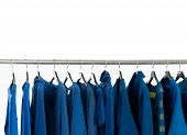 stock photo of habilis  - Set of female blue dress and coat isolated on hanging  - JPG
