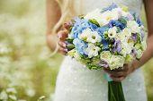 image of sanctification  - Wedding bouquet in hands of the bride - JPG