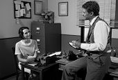stock photo of 1950s style  - Vintage director and female secretary working together in 1950s style office.