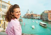 picture of piccolo  - Happy young woman standing on bridge with grand canal view in venice italy - JPG