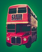 stock photo of upstairs  - Vintage Iconic Red London Bus On A Green Background - JPG