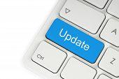 foto of keyboard  - Blue update button on a white keyboard - JPG