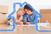stock photo of home addition  - Happy couple organizing their new home against house outline - JPG