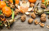 pic of walnut-tree  - Mandarin fruits walnuts and christmas tree branches on wooden background - JPG