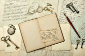 image of nostalgic  - open book vintage accessories old letters and postcards - JPG
