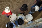 stock photo of brahma-bull  - Cowboys watch a rodeo competition - JPG