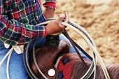 picture of brahma-bull  - A cowboy waits to compete in the roping competition - JPG