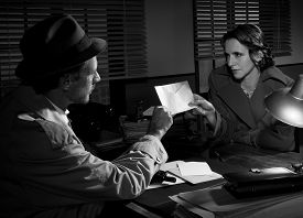 stock photo of 1950s style  - Woman handing over an envelope to a detective at police station 1950s film noir style.