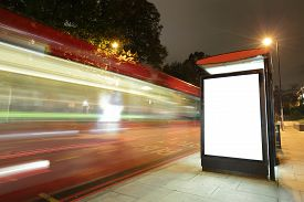 pic of sign-boards  - Blank billboard in bus stop at night with the lights of the cars passing by great copy space for your design shot in London United Kingdom uk - JPG