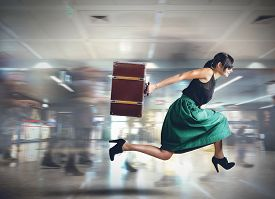 pic of running-late  - Woman runs late to the flight departure - JPG