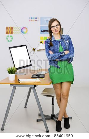 Woman working at desk In a creative office, breaking time