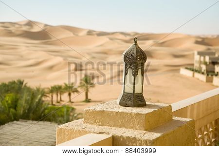 Sand desert, oasis, with arabic buildings and lamp