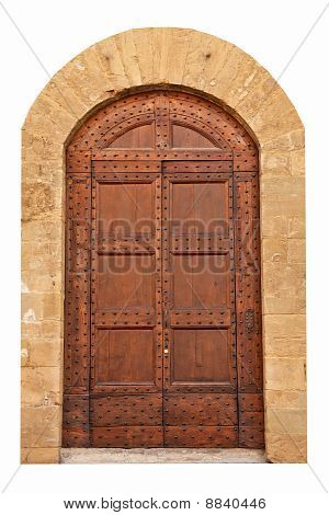Brown door with iron nails.