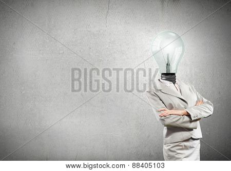 Businesswoman with light bulb instead of head