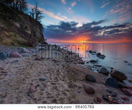 Cliff On Sea Shore At Sunrise. Baltic Sea Long Exposure Photo