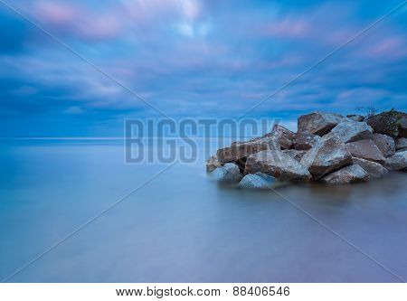 Beautiful Seascape With Stony Breakwater. Long Exposure Photo.