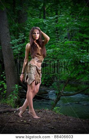 Young barefoot girl in forest