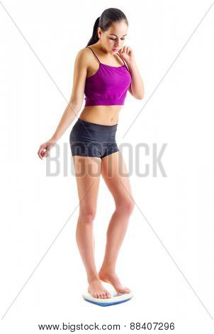 Sporty girl with scales isolated