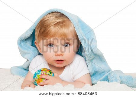 Baby Boy Holds Small Globe In His Hands