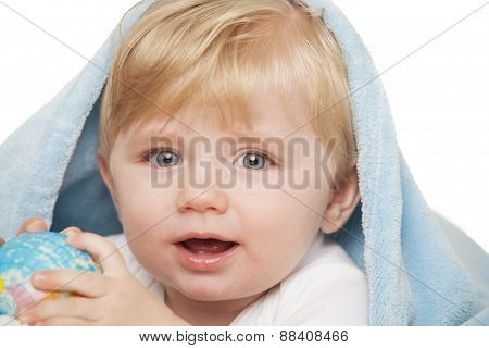 Baby Boy Holds Small Globe In His Hands. Isolated On A White