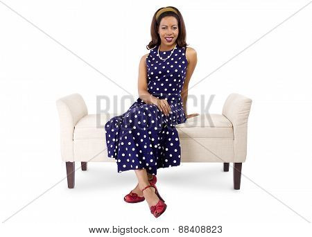 Woman in Vintage Polka Dot Dress on a Chaise Lounge