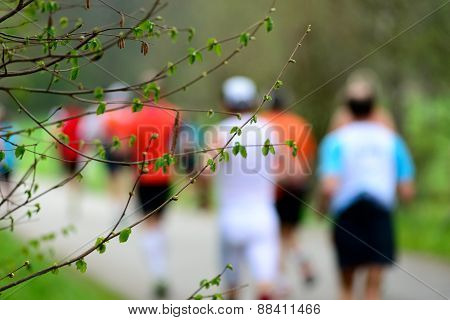 Buds In Spring With Runners In The Background