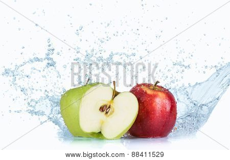 Apples with water splash isolated on white