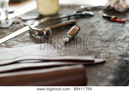 Leather crafting tools on working desk