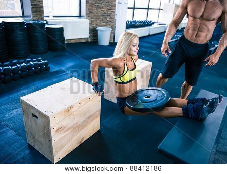 Beautiful young fit woman workout at gym
